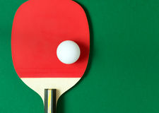 Ping pong paddle with ball Royalty Free Stock Image