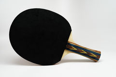 Ping Pong Paddle. With the black side facing the camera. Colorful grip Royalty Free Stock Photography