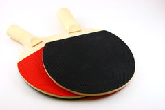 Ping pong paddles. Details of red and black ping pong or table tennis paddles. White background stock photo