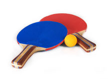 Ping Pong Paddles and Ball. A blue ping pong paddle and a red ping pong paddle sitting with a yellow ping pong ball Stock Images