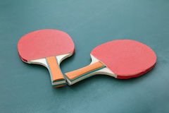 Ping pong paddles on a board Stock Photo