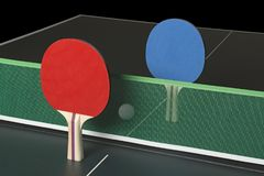 Ping Pong Paddles on Table, standing upright Stock Photo
