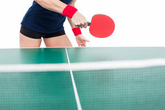 Ping pong player hitting the ball Royalty Free Stock Photography