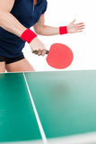 Ping pong player hitting the ball Stock Photography