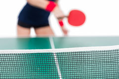 Ping pong player hitting the ball Royalty Free Stock Photos