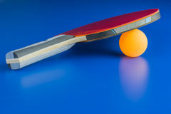 A ping-pong racket. With a orange ball Royalty Free Stock Images