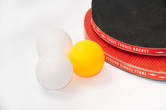 Ping pong rackets with balls Stock Photography
