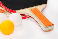 Ping pong rackets with package of balls Royalty Free Stock Photos