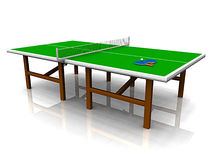 Ping pong table. A ping pong table with two paddles and a ball on it Royalty Free Stock Photography
