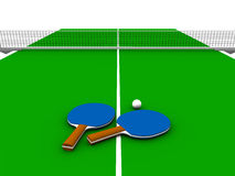 Ping pong table. A ping pong table with two paddles and a ball on it Royalty Free Stock Photos