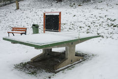 Ping pong table in a park during snowstorm Stock Photography
