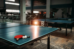 Ping pong table, rackets and balls in a sport hall Royalty Free Stock Images