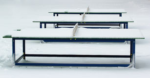 Ping pong tables covered with snow in winter park Royalty Free Stock Photography