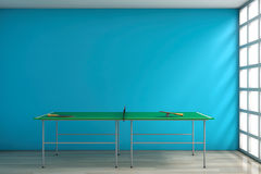 Ping-pong Tennis Table with Paddles. 3d Rendering. Ping-pong Tennis Table with Paddles against a blank blue wall in room. 3d Rendering Royalty Free Stock Photos