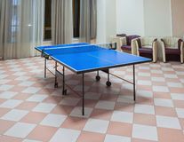 Ping-pong tennis table with Paddles on the floor. Old Style . Ping-pong tennis table with Paddles on the floor Stock Photos