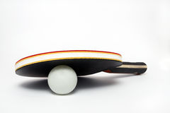 Ping pong under paddle on a white background Stock Image