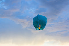 Bright blue paper Lantern flying in the sky Royalty Free Stock Photo