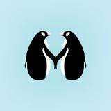 Pingüinos de los pares que llevan a cabo las manos; ejemplo lindo de la historieta en fondo azul Imagen de archivo