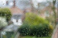Pingos de chuva em um indicador Foto de Stock Royalty Free