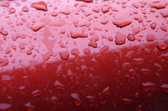 Pingos de chuva no carro Fotografia de Stock