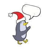 pingouin de Noël de bande dessinée avec la bulle de la parole Photo stock