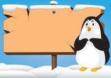 Pingouin et enseigne   Photographie stock