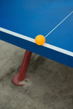 Pingpong ball hits the edge of a pingpong table Stock Images