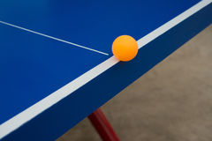 Pingpong ball hits the edge of a pingpong table Stock Photos