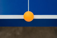 Pingpong ball hits the edge of a pingpong table Stock Images