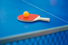 Pingpong racket and ball and net on a pingpong table Royalty Free Stock Images