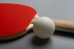 Pingpong rackets and ball on grey Stock Photography