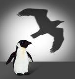 Pinguin mit Adlerschatten. Konzeptgraphik Lizenzfreie Stockbilder
