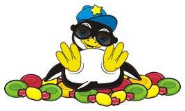 Pinguin mit vieler bunten Süßigkeit Lizenzfreie Stockfotos