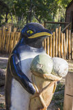 Pinguin sculpture in park Stock Photo
