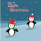 Pinguini che pattinano sul ghiaccio Fotografia Stock Libera da Diritti