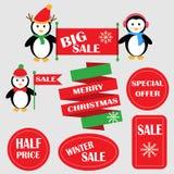 Pinguini con le insegne di vendita Immagine Stock