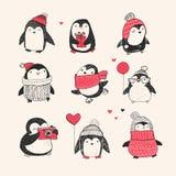 Pinguini disegnati a mano svegli messi - Buon Natale Fotografia Stock
