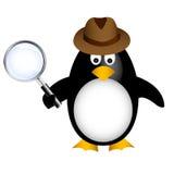 Pinguino dell'agente investigativo con l'ingrandimento Fotografia Stock