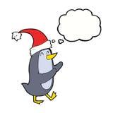 pinguino di natale del fumetto con la bolla di pensiero Fotografia Stock