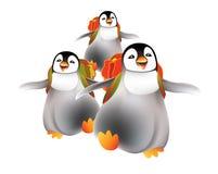 Pinguins felizes dos bebês que vão para trás ao berçário Fotografia de Stock Royalty Free