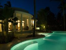 Villa with illuminated swimming pool royalty free stock image