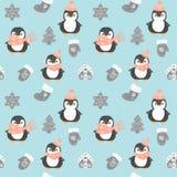 Pingwinu bezszwowy wzór Śliczni pingwiny w czerwonym Bożenarodzeniowym kapeluszu i szaliku odizolowywających na błękitnym tle z r ilustracji