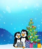 Pingwinu rodzinny Bożenarodzeniowy temat 3 Zdjęcie Royalty Free