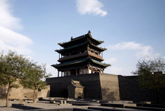 Pingyao ancient city gate house. In the background of the blue sky stock image