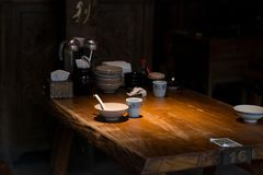 Pingyao, China - 08 13 2016: Asian spoon and bowl in a chinese traditional restaurant in Pingyao, China.  royalty free stock photo