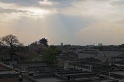 Pingyao stad i solnedgången Arkivfoto
