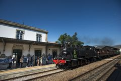 Pinhao, portugal - july 15, 2017: an ancient steam train enters pinhao station. Portugal Royalty Free Stock Photography