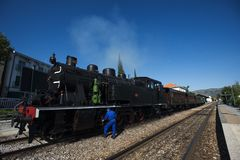 Pinhao, portugal - july 15, 2017:a mechanich fixes an ancient steam train. Pinhao, portugal - july 15, 2017: a mechanic fixes an ancient steam train in pinhao Royalty Free Stock Photos