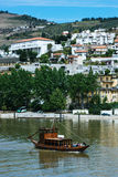 Pinhao village in Portugal. Douro valley and river with boat Royalty Free Stock Images