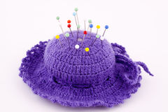 Pinheads in pin cushion. Colored pinheads in pin cushion on a white background royalty free stock photo